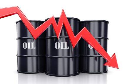 Falling oil price. Red arrow graph chart moving down near the barrels with oil.